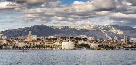 Split, Croatia - Panoramic view of the city from the water, cloudy sky and buildings in the shade