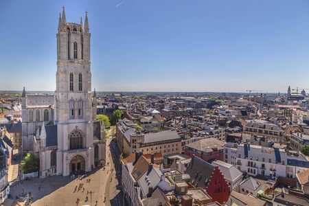 Ghent, Belgium-Panorama of the city from the  Belfry of Ghent in the noon hour and Sunny day, the Cathedral of St. Bavon in the foreground Stock fotó