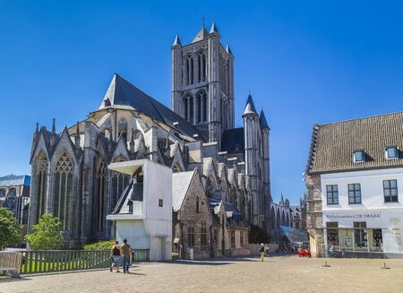Ghent, Belgium-may 07, 2018: St. Nicholas Church and the adjacent street of the city with people passing by Stock fotó