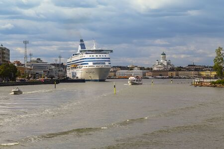 Helsinki, Finland - MAY 05, 2019: Capital of Finland, South Harbor and Silja Line ferry departing from the pier. Sajtókép