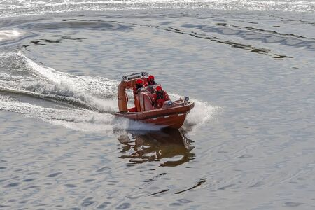 Turku, Finland-may 07, 2012: Rescue boat with crew maneuvers at sea