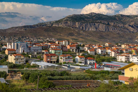 Croatia - Numerous houses in a remote area of Stobrec and in Kamen in the background the mountain massif