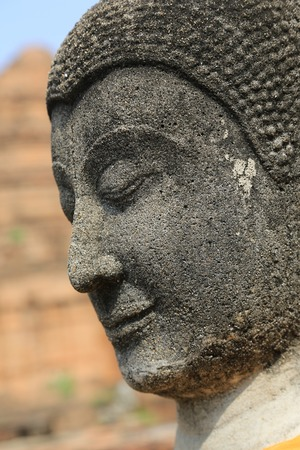 face of Buddha in Thailand photo