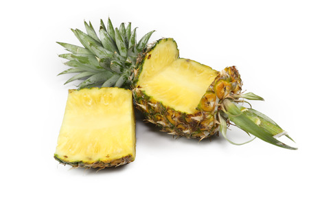 Pineapple peel and slices is a fresh fruit on white background . Stock Photo