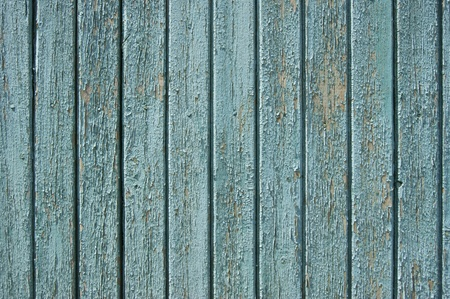 Old wooden fence, painted in blue  photo