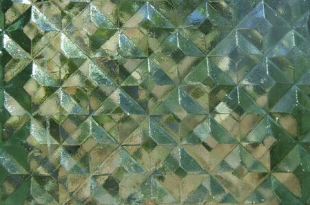 Shiny glass surface in the form of rhombuses   photo