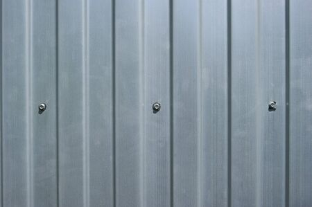 Corrugated metal fence with rivets  photo