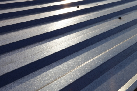 Corrugated metal roof, illuminated by the Sun  photo