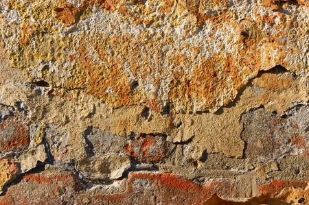 concrete surface finishing: Abstraction  the old multi-colored plastered wall