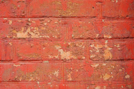 Pared de ladrillo con los restos de pintura marr�n y rojo photo
