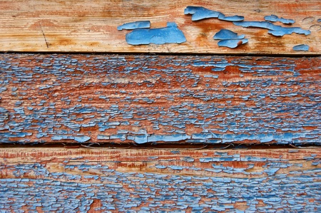 Old board surface with the remains of dark blue paint Stock Photo - 19470384