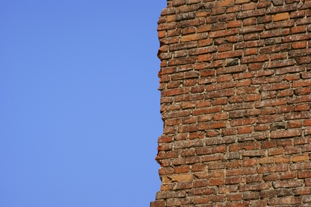 uneven edge: Old wall on the sky background  Stock Photo