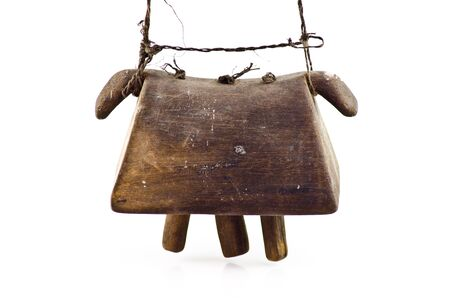 old wooden cowbell