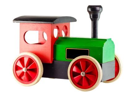 白い背景の上の古いヴィンテージの木製おもちゃ列車します。