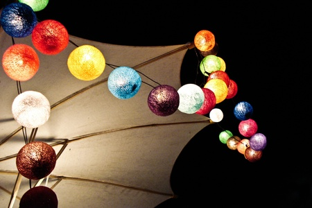 many colorful decorating light balls around an umbella