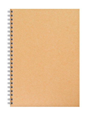 a spiral notebook with blank brown cover photo