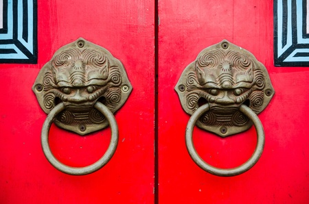 Red chinese door with a lion/dragon head Stock Photo - 15825725