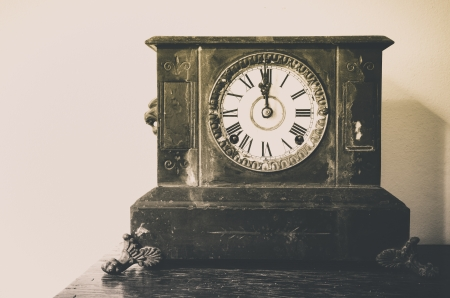 Old Vintage clock on old wooden set photo