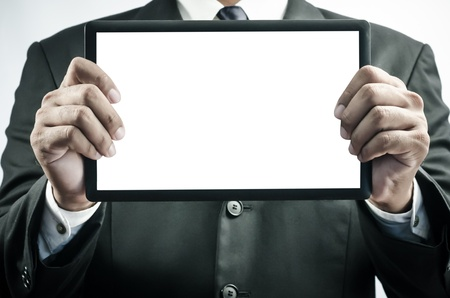 Businessman holding a tablet photo
