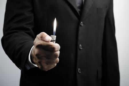 business man holding lighter