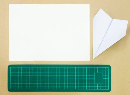 Cutting Mat and paper airplane Stock Photo