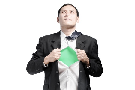 alter ego: Businessman showing a superhero suit underneath his suit Stock Photo
