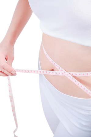 Slim waist with a tape measure around it Stock Photo