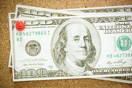 one hundred dollar bill: A one hundred dollar bill tacked to a corkboard, Getting Cash
