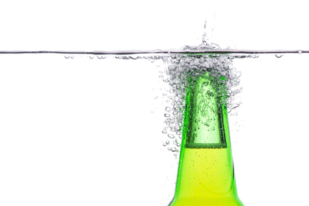 beer bottle: Close up Green beer bottle with water splash isolated on white