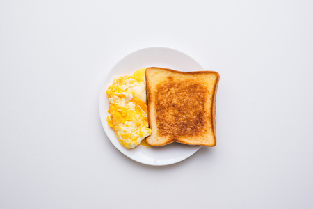 Breakfast - fried egg bread. top view on white background Stock Photo