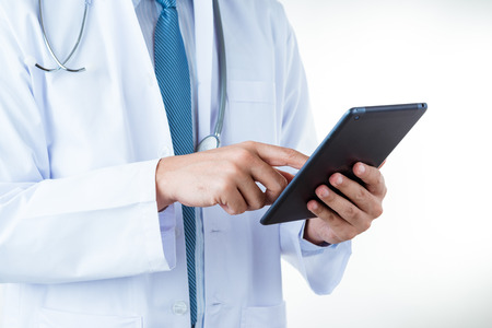 Doctor use tablets computer,Medical Diagnosis And prepare for surgery