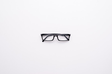 Eye Glasses on White topview with copy space Stock Photo