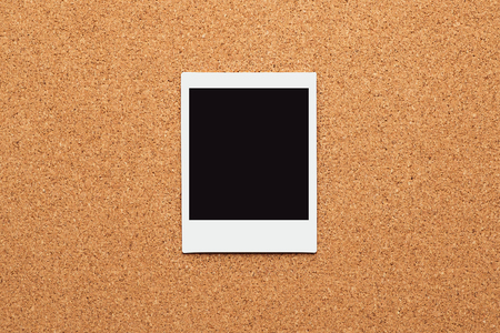 Blank instant photo frames on cork board background Stock Photo