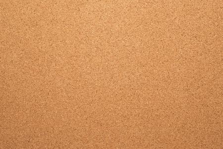 Brown cork board texture. Close up.