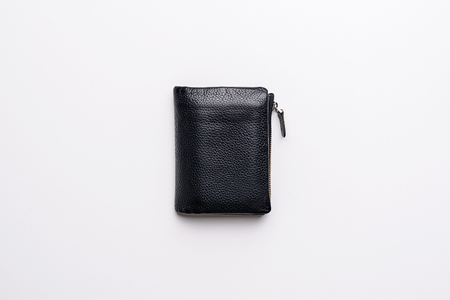 Black natural leather wallet top view on white background