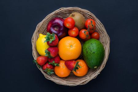 Basket of fruits: strawberries apple orange kiwi lemon topview