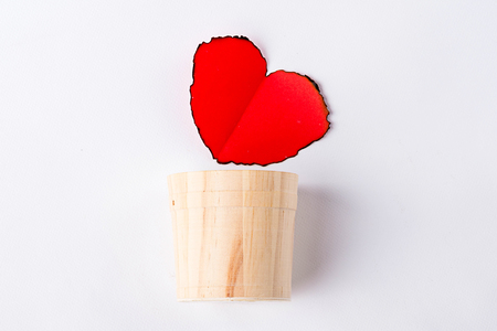 red heart and casks on white background