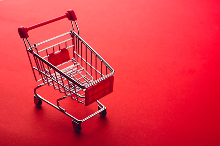 shopping cart on red backgrpund Stock Photo - 70668404