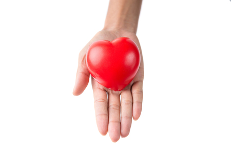 woman hands giving red heart