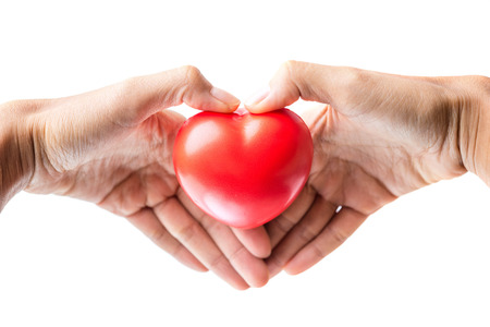 doctor holding gift: woman hands giving red heart