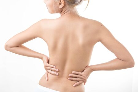 tied in: Loin spasm. Young woman with hurt backbone. Spine inflammation,health care concept