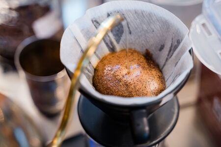 Pouring the hot water for dripping the coffee Stock Photo