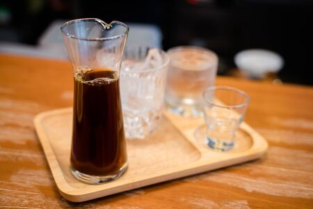 Hot dripped coffee served with a glass of ice