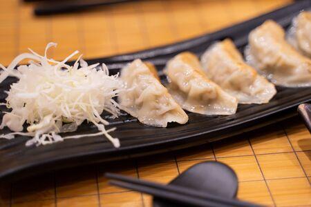 Fried Gyoza with sliced cabbage Japanese style Stock Photo