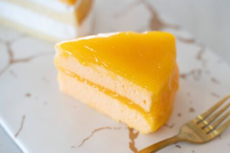An Orange cake on the Marble pattern plate