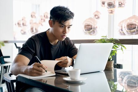 Close-up view of young successful businessman planing the strategy on labtop