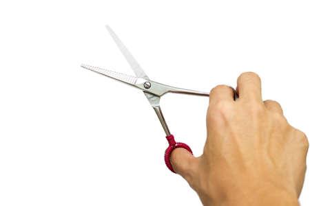 hand grip: A salon scissors in hand grip.