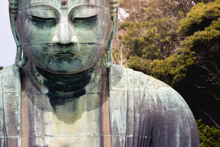 role models: Big buddha with trees and blue sky background
