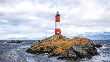 The Les Eclaireurs lighthouse in the Beagle channel looks amazing in a cold summer day. Stock Photo