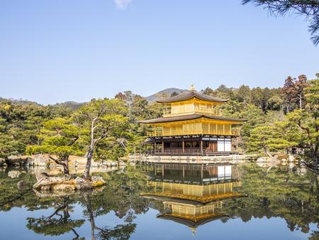 The Kinkaku-ji golden temple reflected on the water in Kyoto, Japan